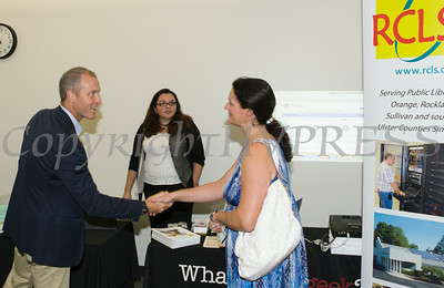 "US Rep Sean Patrick Maloney greets Mary Roth after he hosted ""When Women Succeed, America Succeeds"" Forum and Resource Fair Saturday, July 26 at the Orange County Emergency Services Center in Goshen, NY. Hudson Valley Press/CHUCK STEWART, JR."