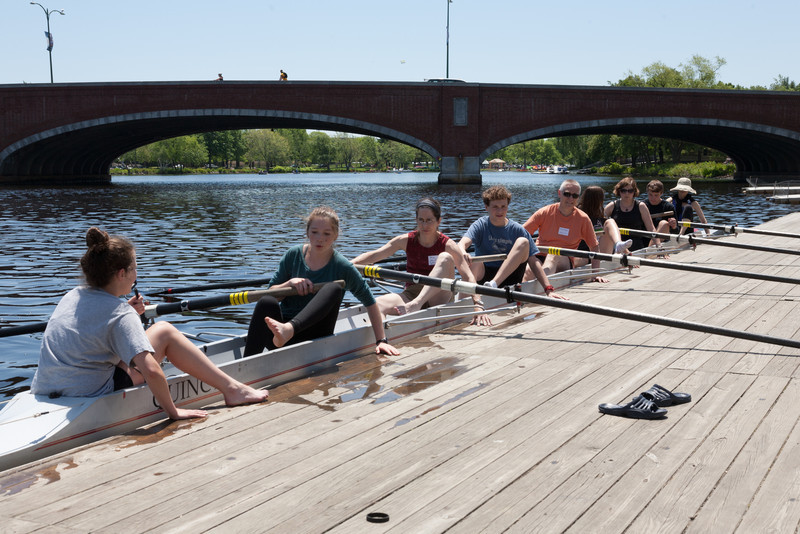 First parent row boat back on the dock, one foot out