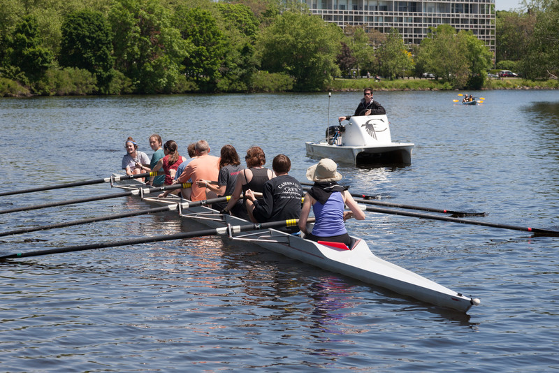 First parent row boat approaching the dock, with coach Marcus
