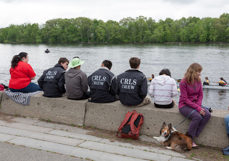 Team members watching from the river bank