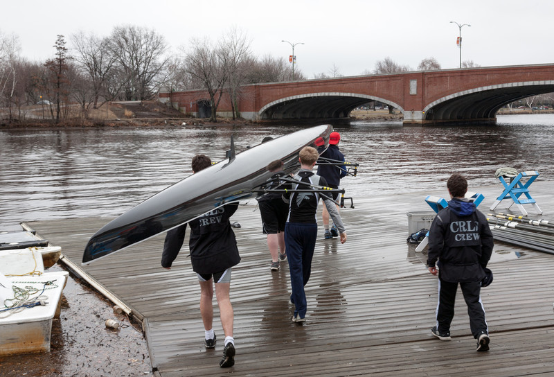 Boys 3V carrying boat on dock