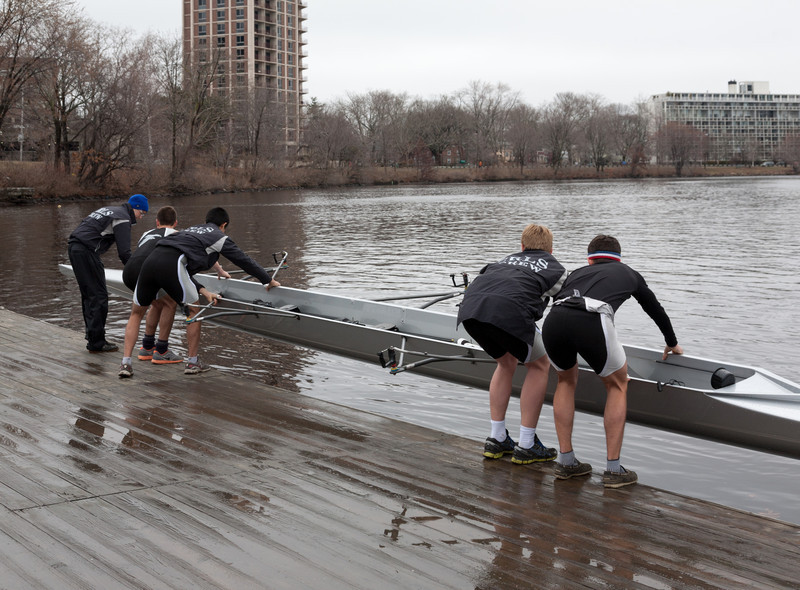 Boys 1V putting boat in the water