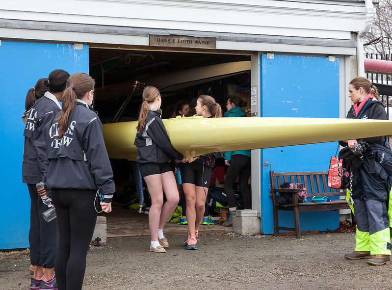 Girls 2V bring out boat with Coach Mary