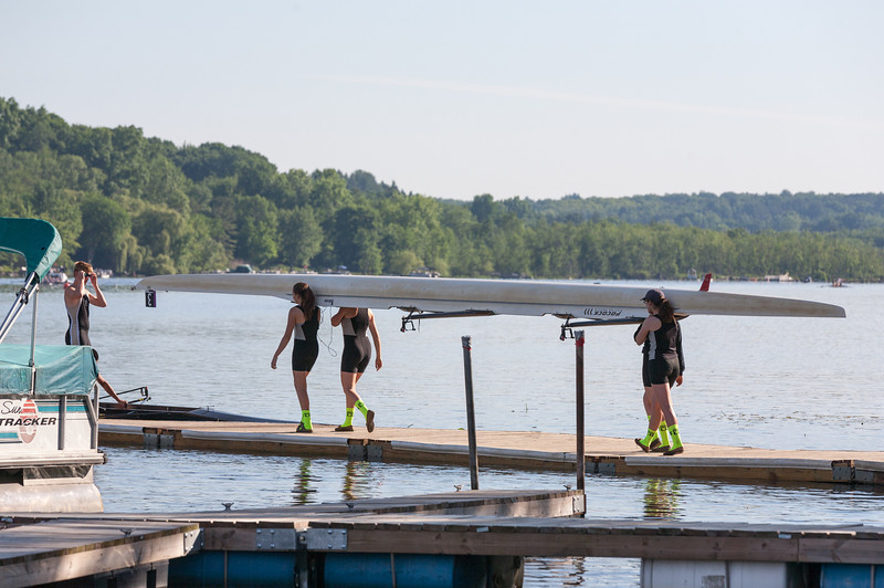 Girls Varsity walking boat on the launch dock