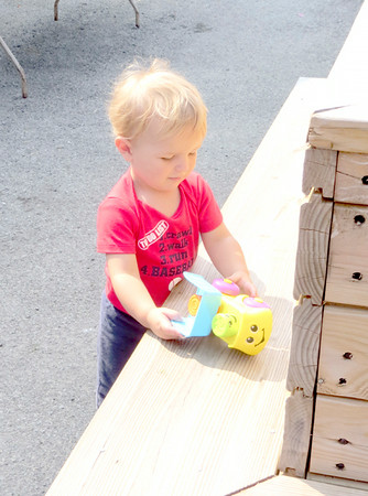 Ian Staples played with a plastic truck Saturday, driving it around a bench encircling a planter. The 20-month-old from Hermitage kept himself occupied as his mother, aunt and other relatives carried their entries into the fair barns. — Mitchel Olszak