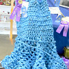 Although this dress looks like it was knitted with jumbo needles, a closer inspection reveals it was created from blue plastic Giant Eagle grocery bags. The work of Leila Zeigler not only earned a first-place ribbon, but a special award from the judges. This was a senior project for Leila, who just graduated from Laurel, where the students were required to make an article of clothing from recycled items. — Mitchel Olszak