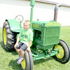 Joey Veronesi, 6, from New Castle helped deliver this 1937-D John Deere tractor to the fairgrounds Saturday. It will be on display with other vintage farm equipment and cars at the Lawrence County Fair this week. — Mitchel Olszak