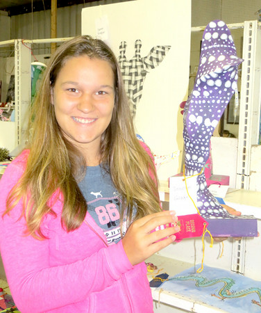 Entries from students ran the gamut from Christmas ornaments to photography to clothing. Josie Slagle, one of the volunteers on hand Saturday, was pleased to see her sculpture — made of wire hangers and pantyhose — earned her a second-place ribbon. Josie will be entering 10th grade at Laurel, where this was an art project. — Mitchel Olszak