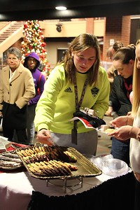 Students and Families gather for a Christmas Celebration of lighting the Tree, music, and fellowship.