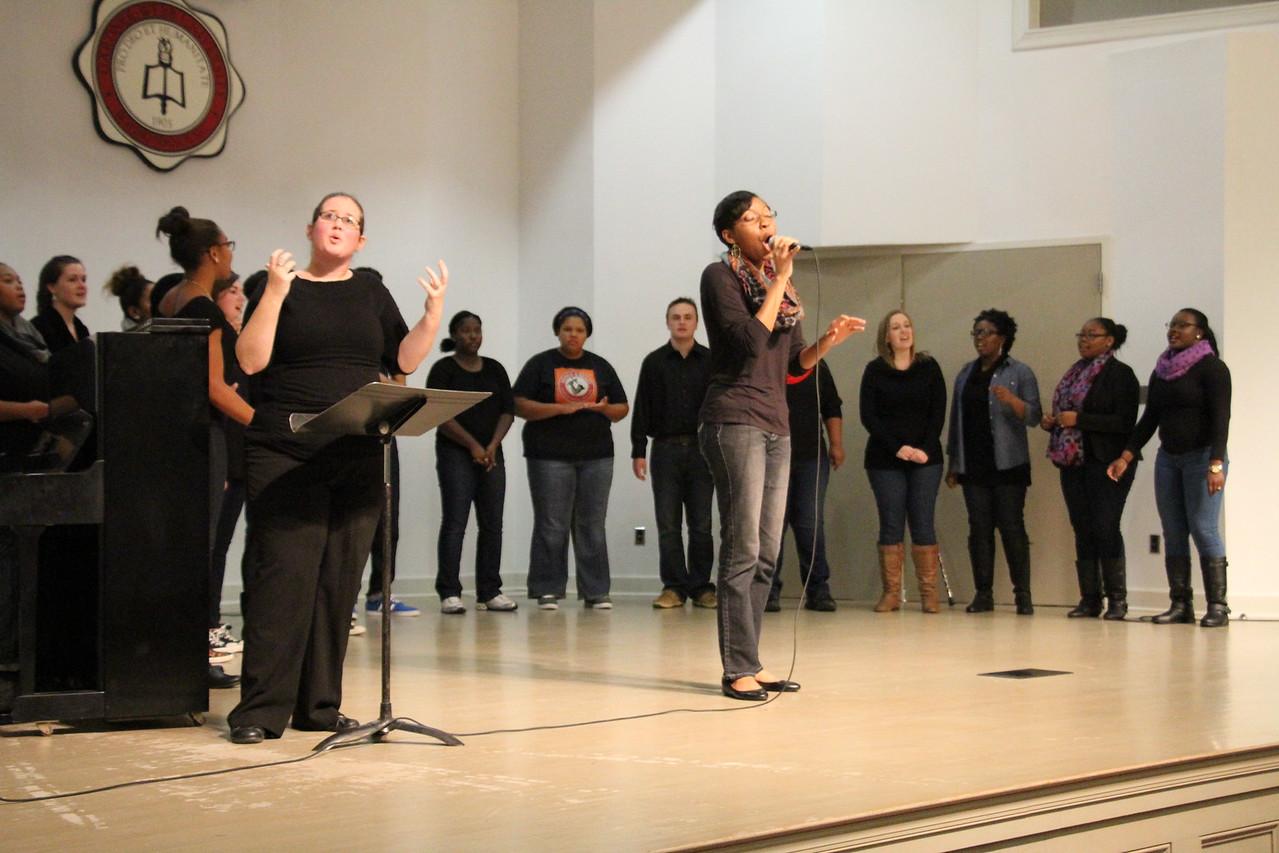 Joyful Hands puts on a Megabash benefit concert including performances by Joyful Hands, Heart of Fire dance ministry, and the Gospel Choir. The Gospel Choir performs their set.