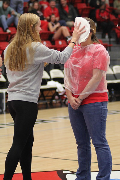 During halftime, 2 athletic trainers were pied in the face.