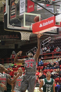 34, Jerome Hill shoots basket.