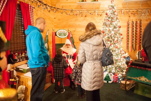 JOED VIERA/STAFF PHOTOGRAPHER-Lockport, NY-Families meet Santa at his Christmas Cottage. Tuesday, December 9, 2014