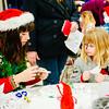 JOED VIERA/STAFF PHOTOGRAPHER-Pendleton, NY- Mari Santangelo a Starpoint Junior helps MacKenzie Yerdon 5 make snowflakes at Starpoint High School. Tuesday, December 16, 2014
