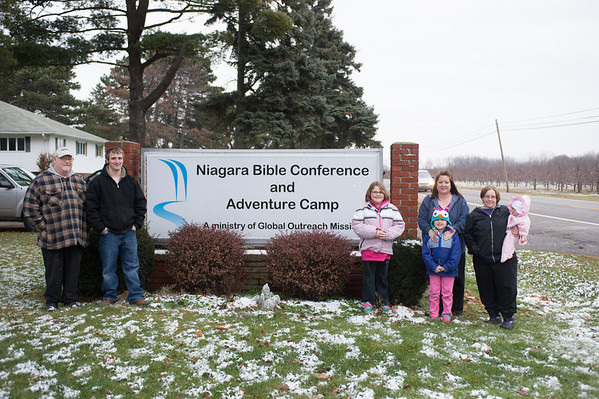 JOED VIERA/STAFF PHOTOGRAPHER Lockport, NY-Andrew Windham, Troy Noble, Autumn Windham, Brianna Windham, Denise Noble, and Amanda holds her daughter Lily-Rose. at the Niagara Bible Conference and Adventure Camp. Thursday, December 18, 2014