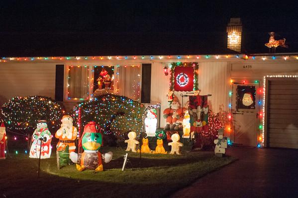 JOED VIERA/STAFF PHOTOGRAPHER-Lockport, NY-Holiday decorations surround a home on Hamm Road . Tuesday, December 9, 2014