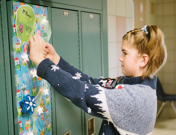 JOED VIERA/STAFF PHOTOGRAPHER Lockport, NY-McKenna Koch an Emmet Belknap fifth grader decorates her locker. Friday, December 19, 2014