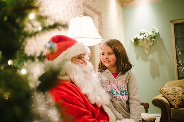 JOED VIERA/STAFF PHOTOGRAPHER-Newfane, NY-Lauren Enderton 7 asks Santa for a Monster High doll. Friday, December 5, 2014.