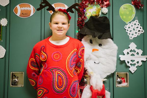 JOED VIERA/STAFF PHOTOGRAPHER Lockport, NY-Tiffany Sprung an Emmet Belknap fifth grader stands by her festivly decorated locker. Friday, December 19, 2014