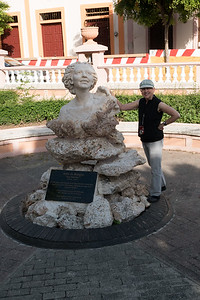 Lois with statue honoring Julia de Burgos, poet and militant against the tyranny of Rafael Trujillo (1914 – 1953)