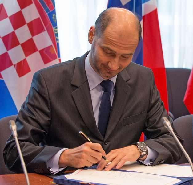 Joško Klisović, Deputy Minister of Foreign and European Affairs of Croatia, signing the EEA Enlargement Agreement on 11 April 2014