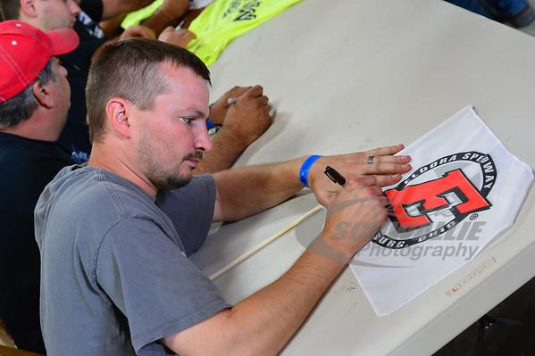 Casey Noonan signs an autograph