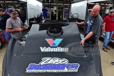 Robby Allen gets Gregg Saterlee's car ready to go