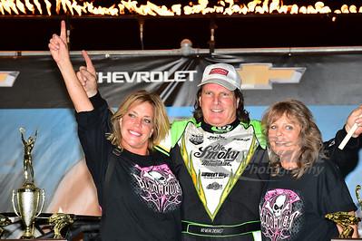 Scott Bloomquist in Victory Lane with wife - Katrina Bloomquist and mother - Georgie Bloomquist