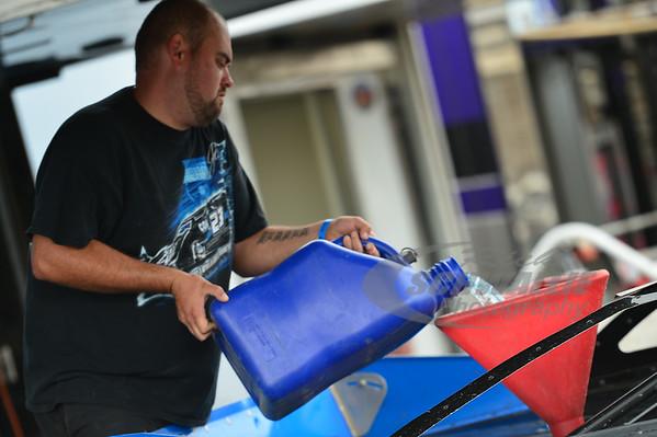 John Blankenship crew member fills the car up with fuel