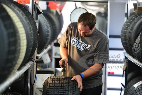 John Blankenship crew member - JC Crockett prepares a tire