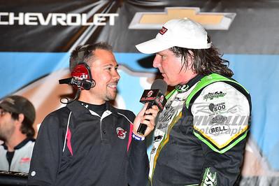 Scott Bloomquist being interviewed by Dustin Jarrett in Victory Lane