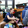 Sarah Gift '18 from Washington Crossing, PA, unpacks. Behind her is roommate Alexa Chabora '18 from Ramsey, NJ.<br /> Photo Credit: Paola Nogueras