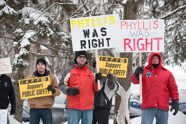 140211 PROTEST  JOED VIERA/STAFF PHOTOGRAPHER-Lockport, NY- Protestors hold up signs in front of the Lockport Country Club during Mayor Michael Tucker's state of the city address on Tuesday February 11th, 2014.