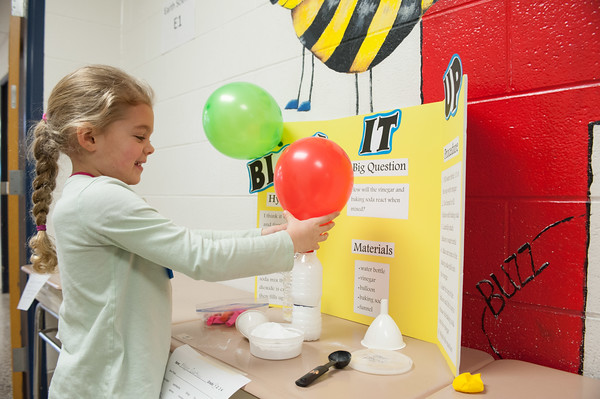 140228 Newfane Science JOED VIERA/STAFF PHOTOGRAPHER-Newfane, NY-1st grader Maggie Quattrini fills a balloon up with baking soda and vinager until it inflates in her demonstration at the Newfane Science Fair on Friday February 28th, 2014.