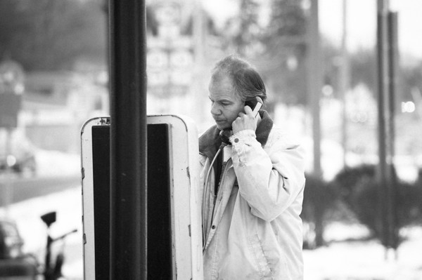 140204 3A ENT JOED VIERA/STAFF PHOTOGRAPHER Lockport ,NY- Robert Grzeczkowski makes a call on the pay phone on the corner of East Ave. and South Transit Road on February 4th, 2014.