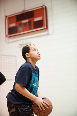 140226 Salvation scoreboard JOED VIERA/STAFF PHOTOGRAPHER-Lockport, NY- Jaheim Lewis(10) plays basketball at the Salvation army on Wednesday February 12th, 2014.