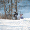 140203 Ice Fish JOED VIERA/STAFF PHOTOGRAPHER Olcott ,NY- Tim Helper walks back from fishing at Fisherman's Park on February 3rd, 2014.