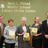140211 Starpoint Author JOED VIERA/STAFF PHOTOGRAPHER-Pendleton, NY-From left to right:Starpoint Superintendent C. Douglas Whelan, Starpoint Middle School Librarian Chris Parker, Carol Moxham Boot, Starpoint Intermediate School Librarian Bonnie Larson and  Principal James Bryer pose for a photo at the Jane L. Olstad Midle School Library on Tuesday February 11th, 2014.