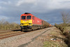 18 February 2014 :: 60059 is seen at Grove Wick Crossing working 6B33 empty oil from Theale to Robeston