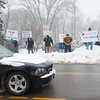 140211 PROTEST  JOED VIERA/STAFF PHOTOGRAPHER-Lockport, NY- Mayor Michael Tucker drives past protestors holding signs in front of the Lockport Country Club before the state of the city address on Tuesday February 11th, 2014.