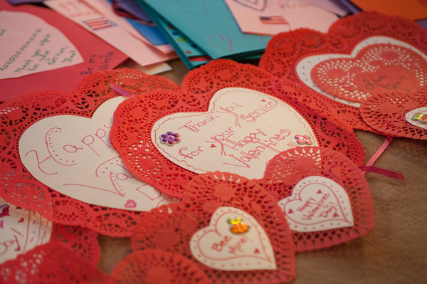 140211 Veterans VdayJOED VIERA/STAFF PHOTOGRAPHER-Lockport, NY- Hundreds of valentines day cards addressed to veterans and soldiers abroad are spread out on Renee Knight's floor on Wednesday February 12th, 2014.