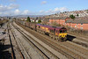 7 February 2014 :: 66008 is pictured passing East Usk Yard, Newport with  6M86 loaded steel from Margam to Dee Marsh.  Pity this working didn't produce a Tug today as there were several in the area!