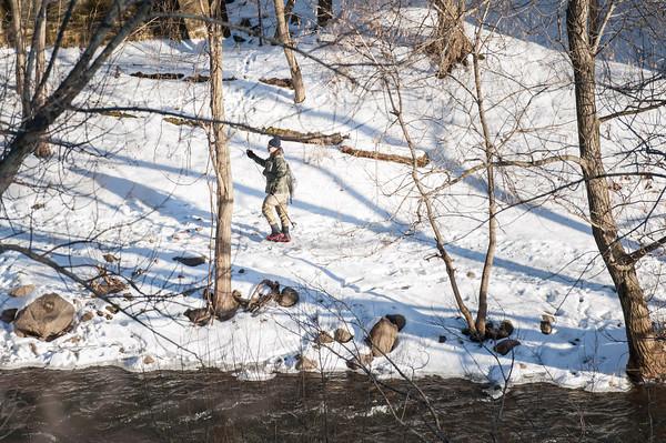 140203 Ice Fish JOED VIERA/STAFF PHOTOGRAPHER Olcott ,NY- A man walks back from fishing at Fisherman's Park on February 3rd, 2014.