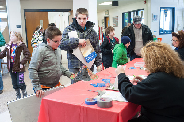 140228 Newfane Science JOED VIERA/STAFF PHOTOGRAPHER-Newfane, NY- Fourth grader Nikolas Patterson registers his volcano display at the Newfane Science Fair on Friday February 28th, 2014.