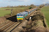 11 February 2014 :: In glorious light, 59005 leaves Westbury with 7C77 from Acton to Merehead