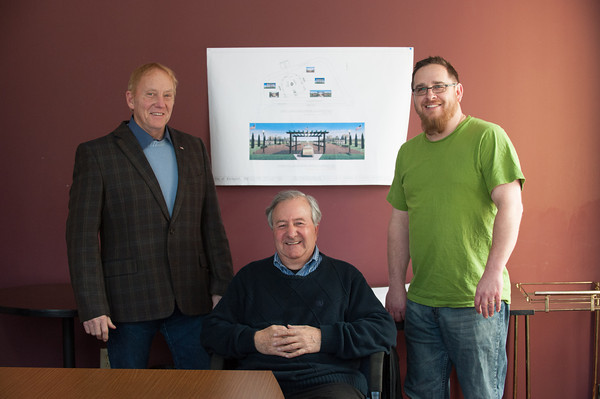 140214 3A Ent  JOED VIERA/STAFF PHOTOGRAPHER-Lockport, NY-From left: Phil Lange, Tony Sammarco and Craig Bacon in front of the plans for the Fallen Heroes Memorial site on Friday February 14th, 2014.