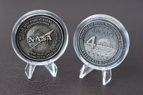 140228 Challenger Center JOED VIERA/STAFF PHOTOGRAPHER-Lockport, NY-These commemorative coins containing metal flown to the moon during the apollo missions will be auctioned to raise funds for programs at the Challenger Center of Orleans Niagara and Erie Counties on Friday February 28th, 2014.