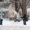 140210 3A Ent  JOED VIERA/STAFF PHOTOGRAPHER-Lockport, NY-North Park Jr. High students Right Armanre Abrahams(right) and Colby Hawk(left) have a snowball fight on Niagara St. after school on Monday February 10th, 2014.