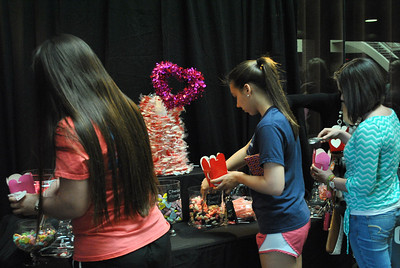 students fill up boxes of candy during a student activities event