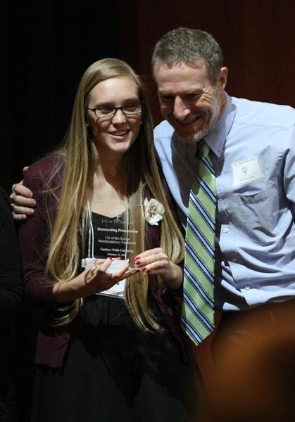 Mentor Dr. Kent Blevins hugs Mary Hellstrom